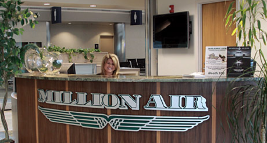 Friendly CSR behind the front desk of Million Air Moses Lake