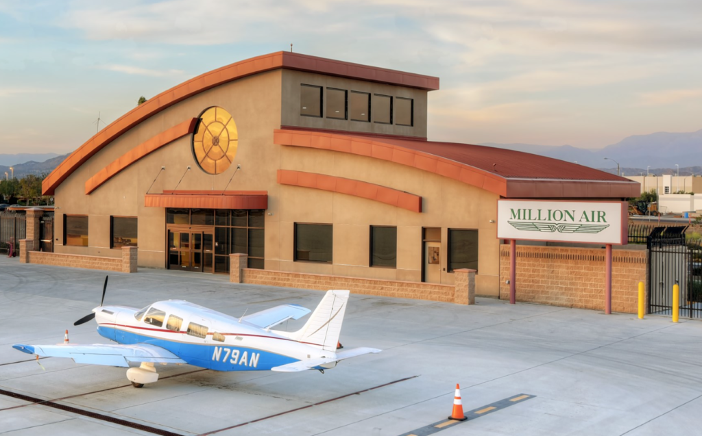 Exterior photograph of Million Air Riverside with small plane in the foreground.