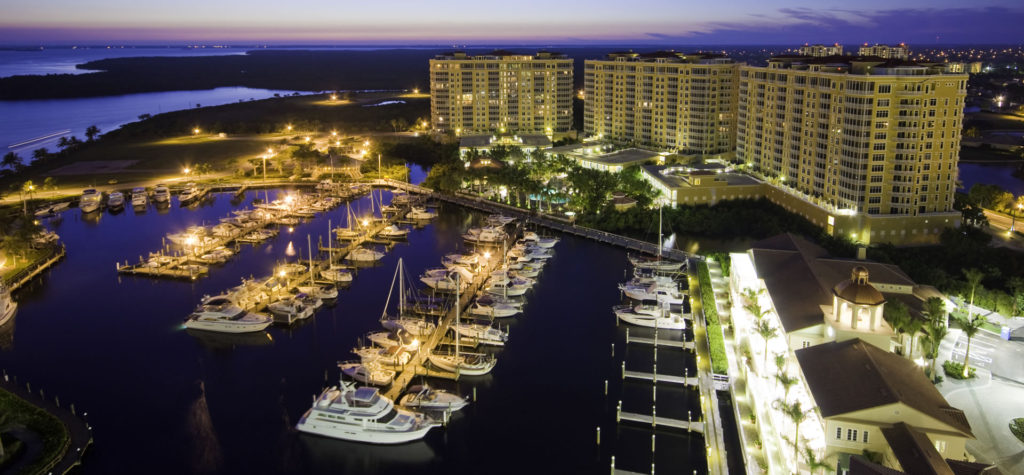 Aerial view of Tarpon Point hospitality location with the marina in the foreground.